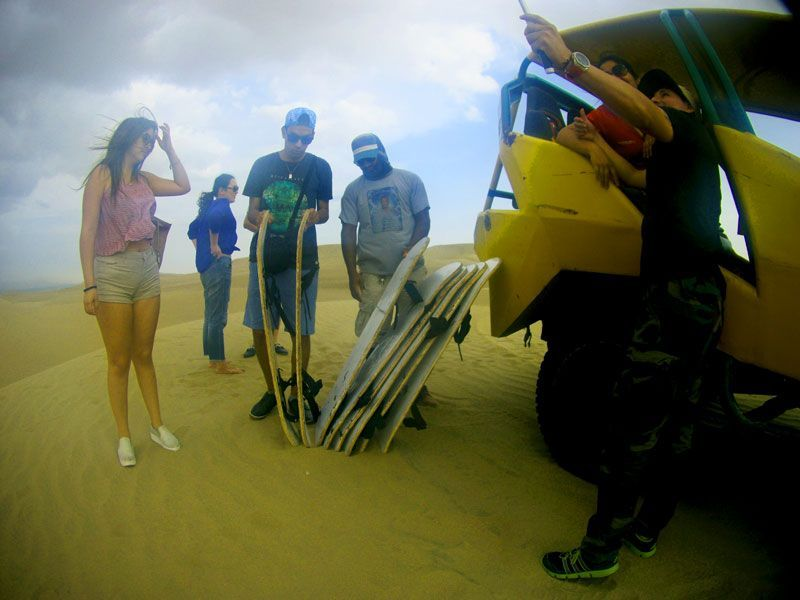 sandboarding in huacachina peru oasis, travel to peru