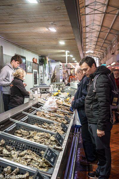 Fer looking at the oysters at Les Halles de La Rochelle